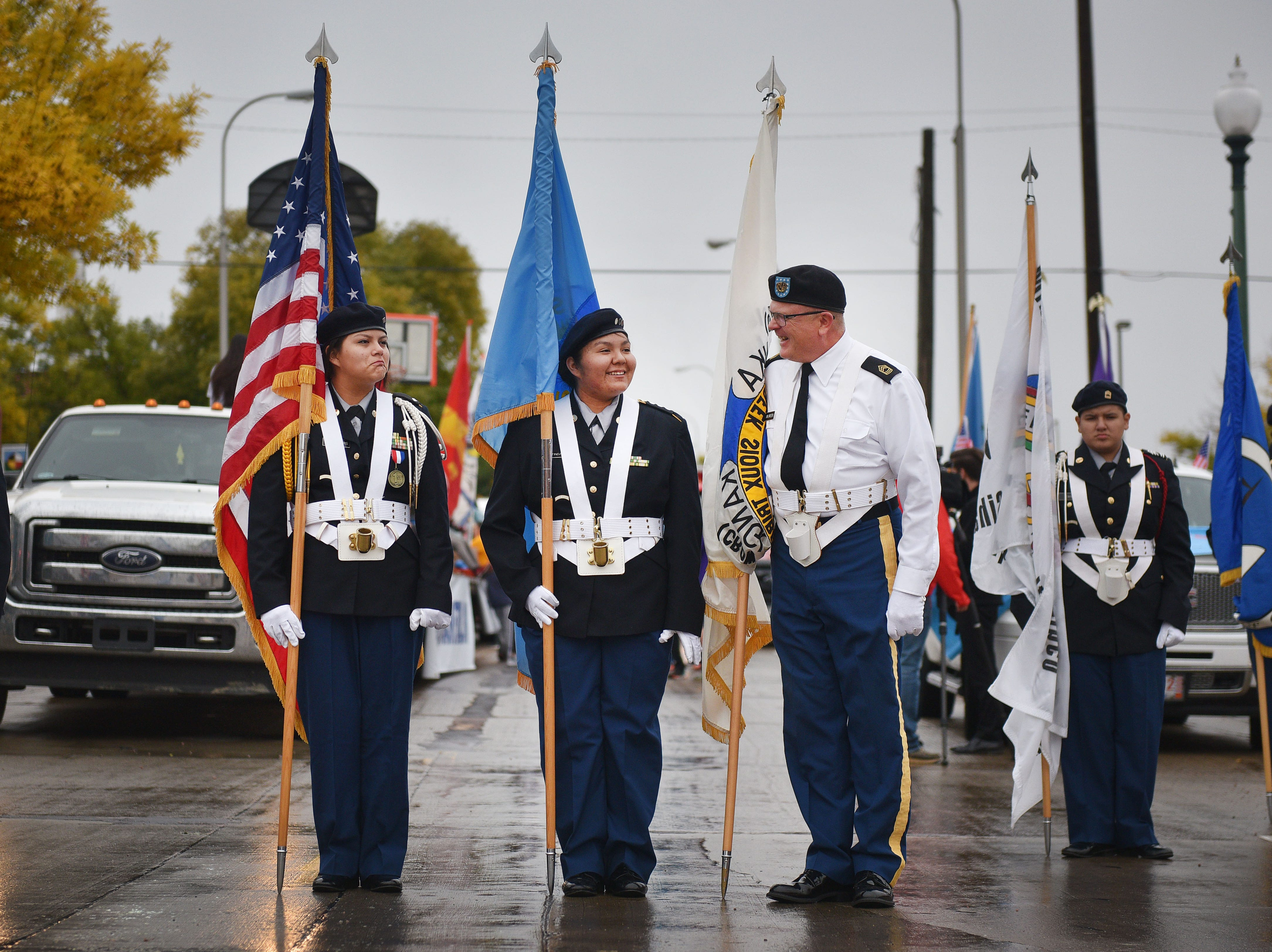 "Flandreau JROTC members Bianca Ten Fingers, from left, Larisscia Tindall, center and Master Sergeant Van Briesen, right, get in formation before the Native Americans' Day parade Monday, Oct. 8, in downtown Sioux Falls. The theme this year was ""Honoring Our Elders."""
