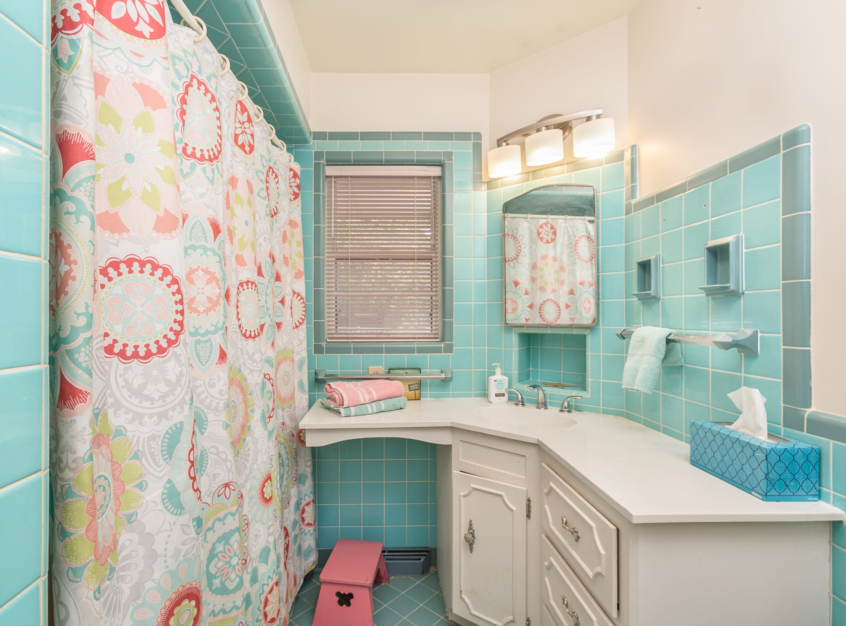 The four bathrooms and a built-in vanity are original. Even the ceilings in the showers are tiled, a rarity today. Keri suspects a second built-in bedroom vanity is concealed by a bedroom wall. That could be a fun discovery for future owners.