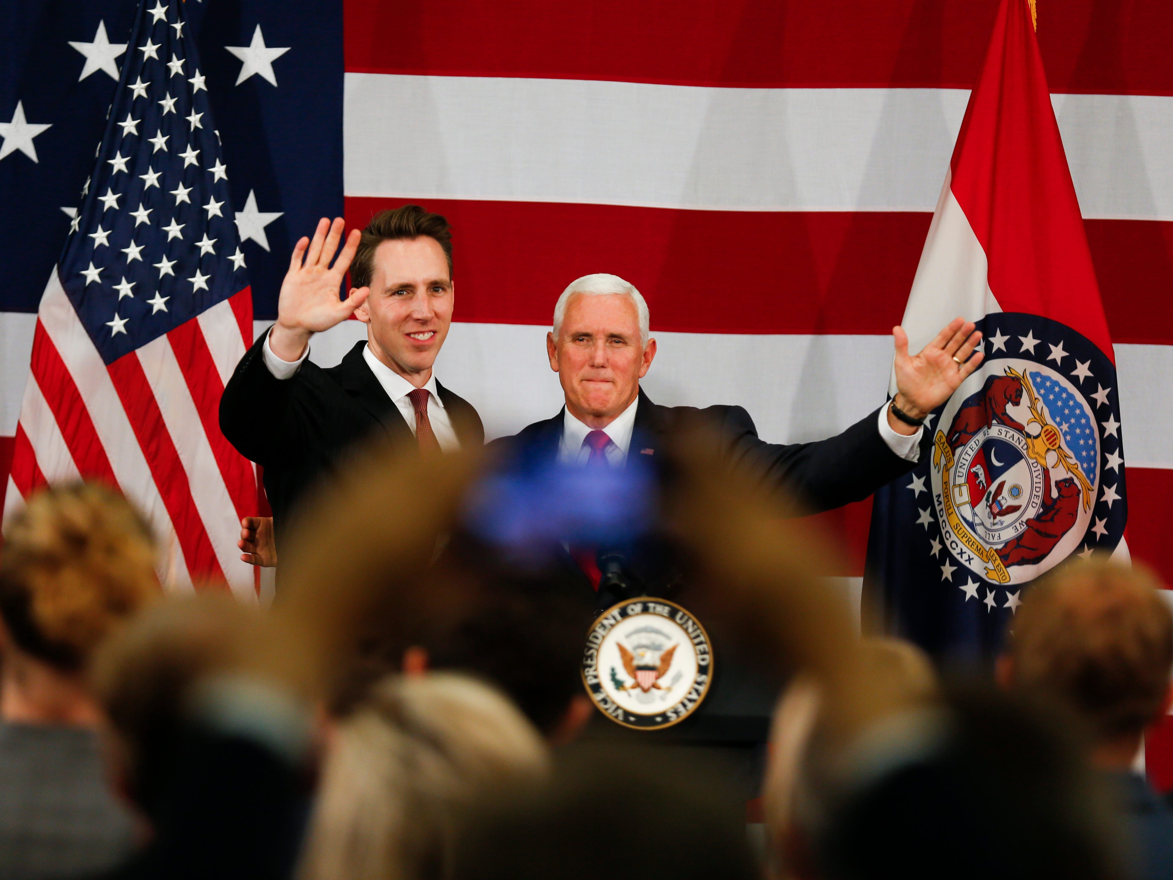 Vice President Mike Pence appears on stage with U.S. Senate candidate Josh Hawley, who is running against Sen. Claire McCaskill in Missouri, at the Oasis Hotel & Convention Center during a private fundraising event in Springfield, Mo. on Monday, Oct. 8, 2018.