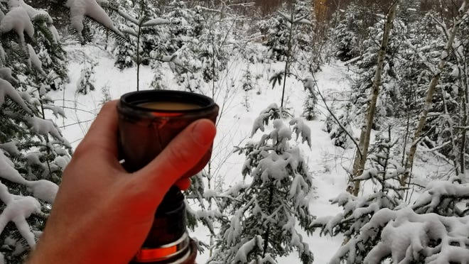 Being warm and comfortable helps hunters stay on stand longer. A cup of coffee keeps the author warm and hydrated on a cold opening day of deer hunting last November.