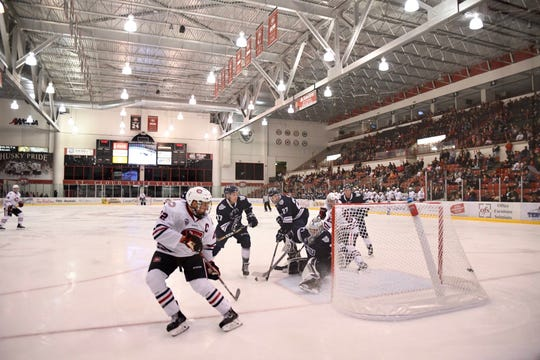 St. Cloud State captain Jimmy Schuldt (left) watches his shot go into the Mount Royal University goal in the second period Sunday at the Herb Brooks National Hockey Center.