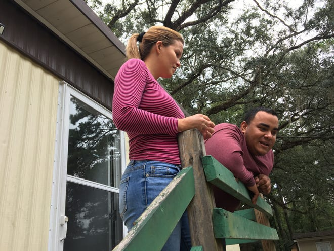 Katia Montalvo, 30, and her husband Jose Martinez, 32, talk about preparing for Hurricane Michael in front of their mobile home in the Greenwood Trailer Park off Old St. Augustine Road Monday, Oct. 8, 2018. They just moved there in January.