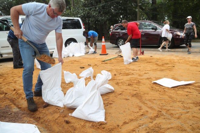 Matt Hefelfinger fills a sand bag at Winthrop Park in Tallahassee, Fla. as Hurricane Michael heads toward the state's coast Monday, Oct. 8, 2018.