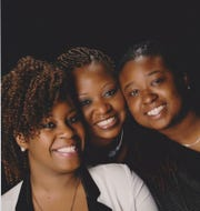Jasmine Goettie pictured with her mother and sister.
