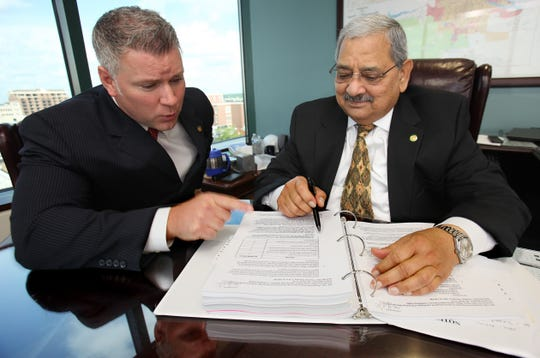 Leon County Administrator Parwez Alam and Deputy County Administrator Vince Long (left) share ideas ion county projects while nside the  fifth floor of the Leon County Courthouse office of Parwez Alam on Tuesday, April 26, 2011. Alam will be retiring in June.