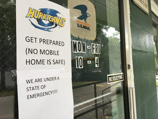 A warning sign is posted on the office door at Greenwood Trailer Park off Old St. Augustine Road Monday morning ahead of Hurricane Michael's landfall.