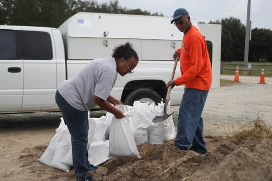 People fill sand bags at Apalachee Regional Park in Tallahassee, Fla. as Hurricane Michael heads toward the state's coast Monday, Oct. 8, 2018.