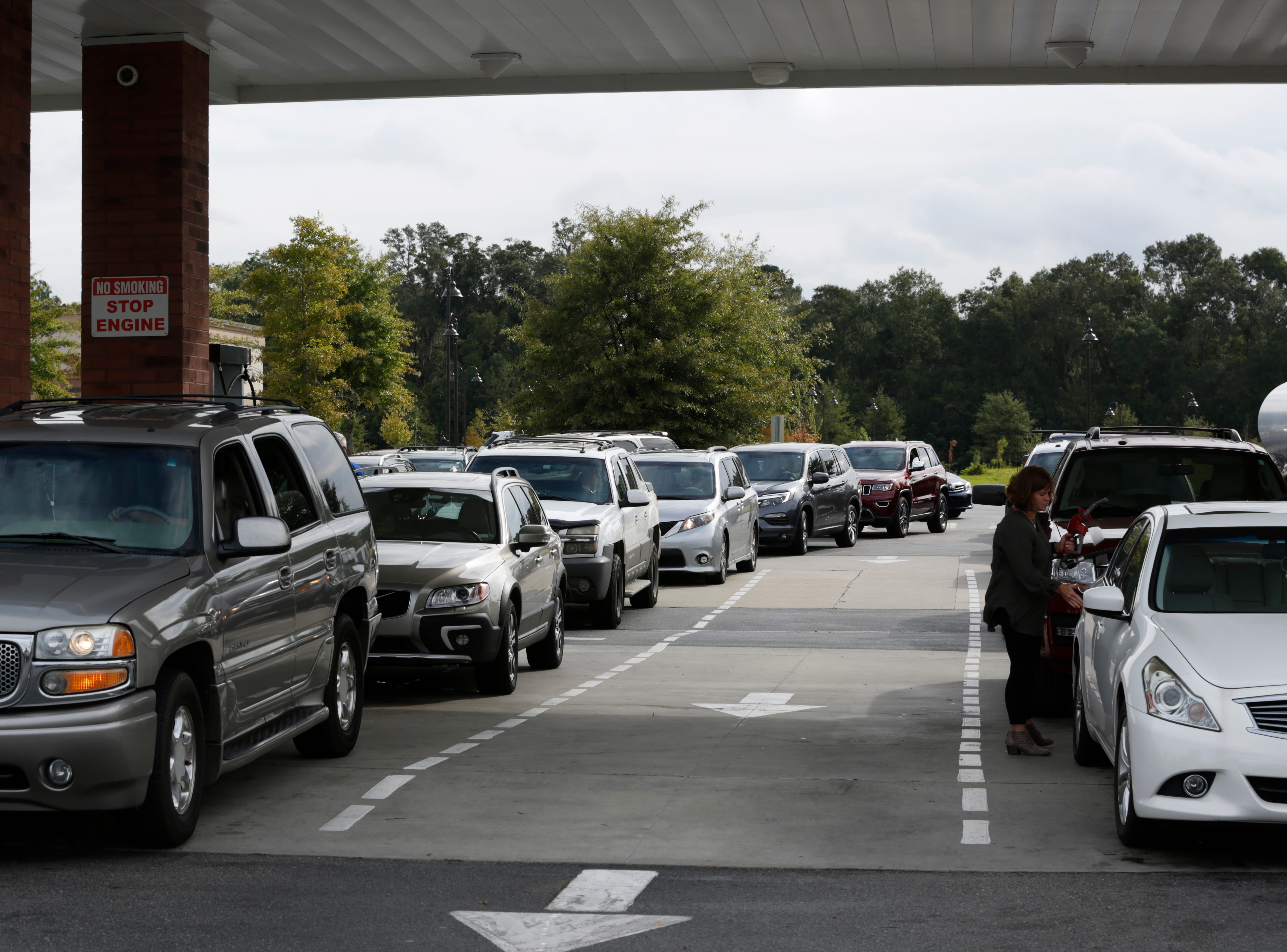 Cars line up at Costco to fill up with gas as Hurricane Michael heads toward the Florida coast Monday, Oct. 8, 2018.