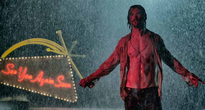 "Chris Hemsworth enjoys the rain in ""Bad Times at The El Royale,"" opening Friday."