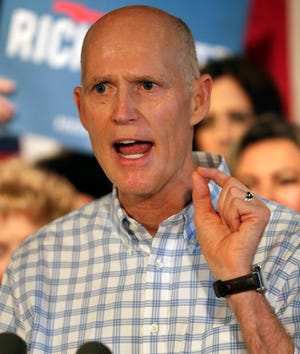 Fla. Gov. Rick Scott speaks to supporters at a Republican rally Sept. 6, 2018, in Orlando, Fla.