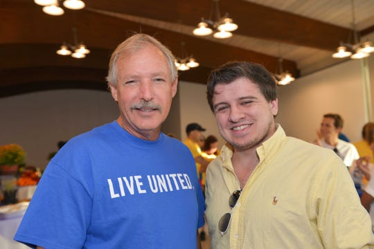 St. Lucie County Administrator and United Way Campaign Chair Howard Tipton, left, with Chris Ketcham, of Mustard Seed Ministries, at the St. Lucie County' Day of Caring, sponsored by Dean Mead.