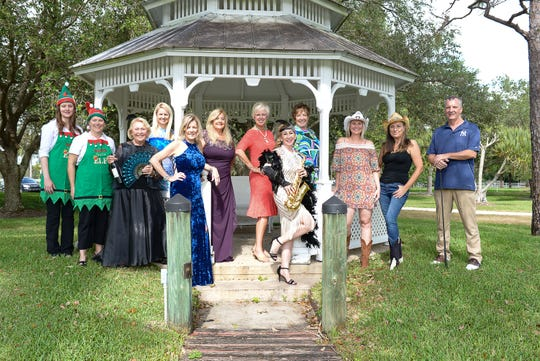 2018-19 Hibiscus Children's Center fundraising event co-chairs, from left, Ashley Braden-Knowles, Ellen Houts, Carole Casey, Kate Mikkelson, Petra King, Rosemary Smith, Diane Wilhelm, Sue Sharpe, Brenda Woolston, Michelle Schwartz, Heidi Monsour, and Mike Henry at the wind Chase Farms gazebo in Palm City.