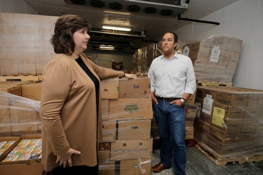 Susan Goodell, CEO of El Pasoans Fighting Hunger Food Bank, stands with U.S. Rep. Hurd inside one of the food bank's coolers. The food bank is kicking off its 75 days for 75,000 pounds of food drive campaign. The drive aims to collect food for distribution to the El Paso community just in time for the holidays.