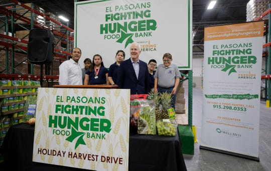 U.S. Rep. Will Hurd, left, and U.S. Sen. John Cornyn pose with students from Clarke Middle School as the El Pasoans Fighting Hunger food bank kicks off its 75 days for 75,000 pounds of food drive. The drive seeks to collect food for distribution to the El Paso community just in time for the holidays.