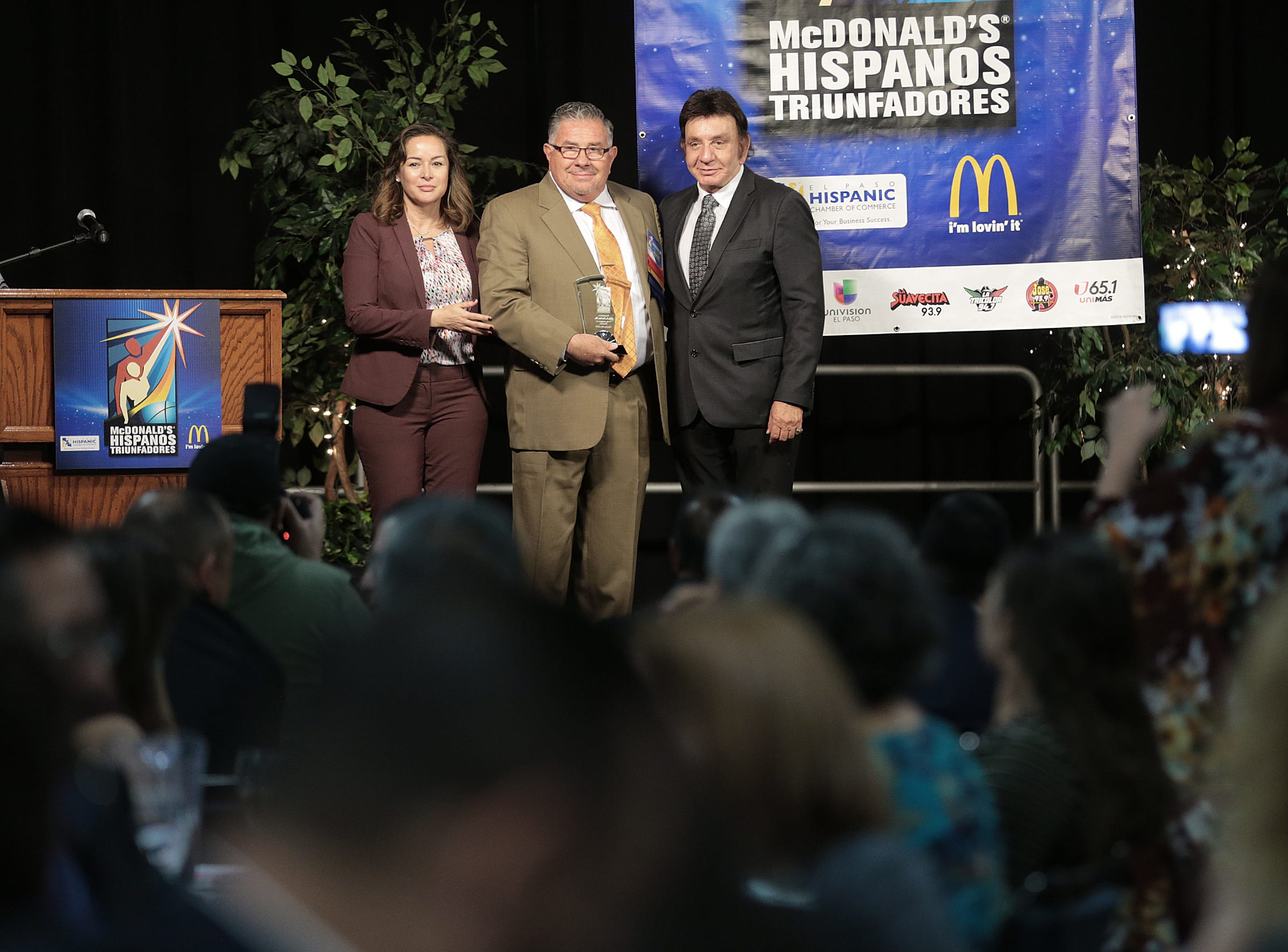 Leo A. Duran, owner of L& J Cafe, accepts his Hispanos Triunfadores Award Monday. Duran was honored for his work in the community.