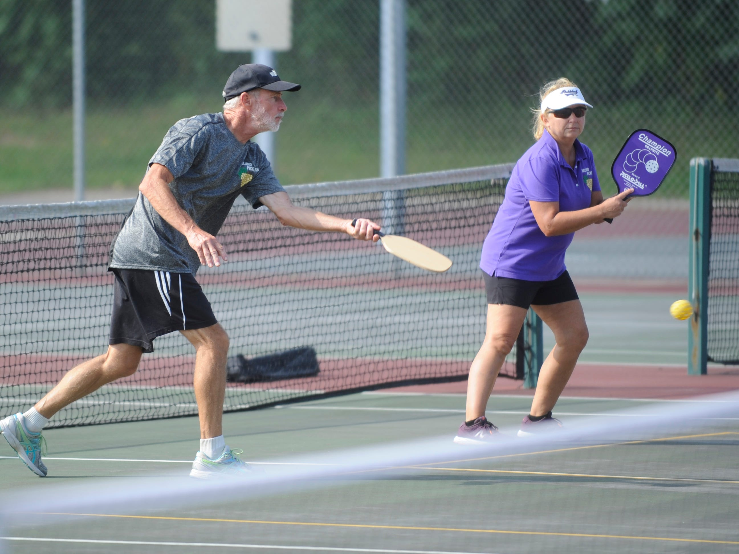 Bill Hayes, 64, and Marylynne Gravino, both of Vineland, play pickleball at Pagluighi Park on Wednesday, October 3, 2018.