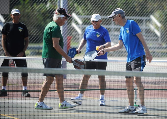 From left to right, Frank Lee, 75 of Vineland, David Gotthold of Vineland and Walter Gifford, 61 of Bridgeton tap paddles after a game of pickleball at Pagluighi Park in Vineland on Wednesday, October 3, 2018.