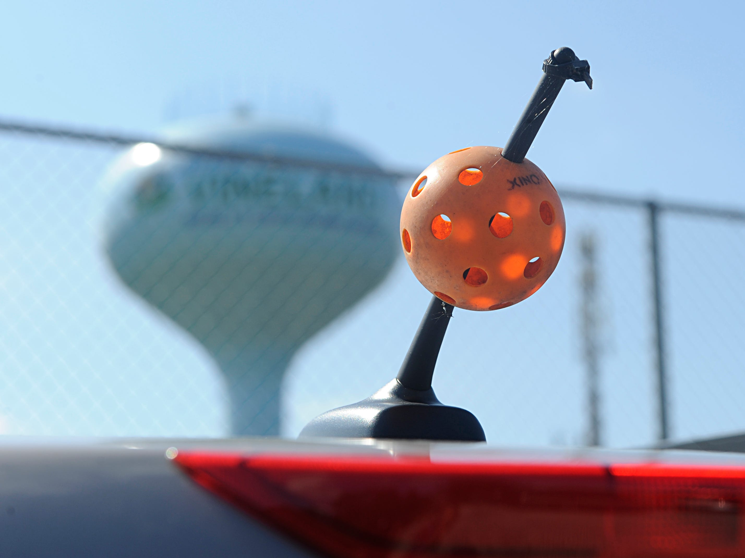 A pickleball adorns a car antenna at Pagluighi Park on Wednesday, October 3, 2018.