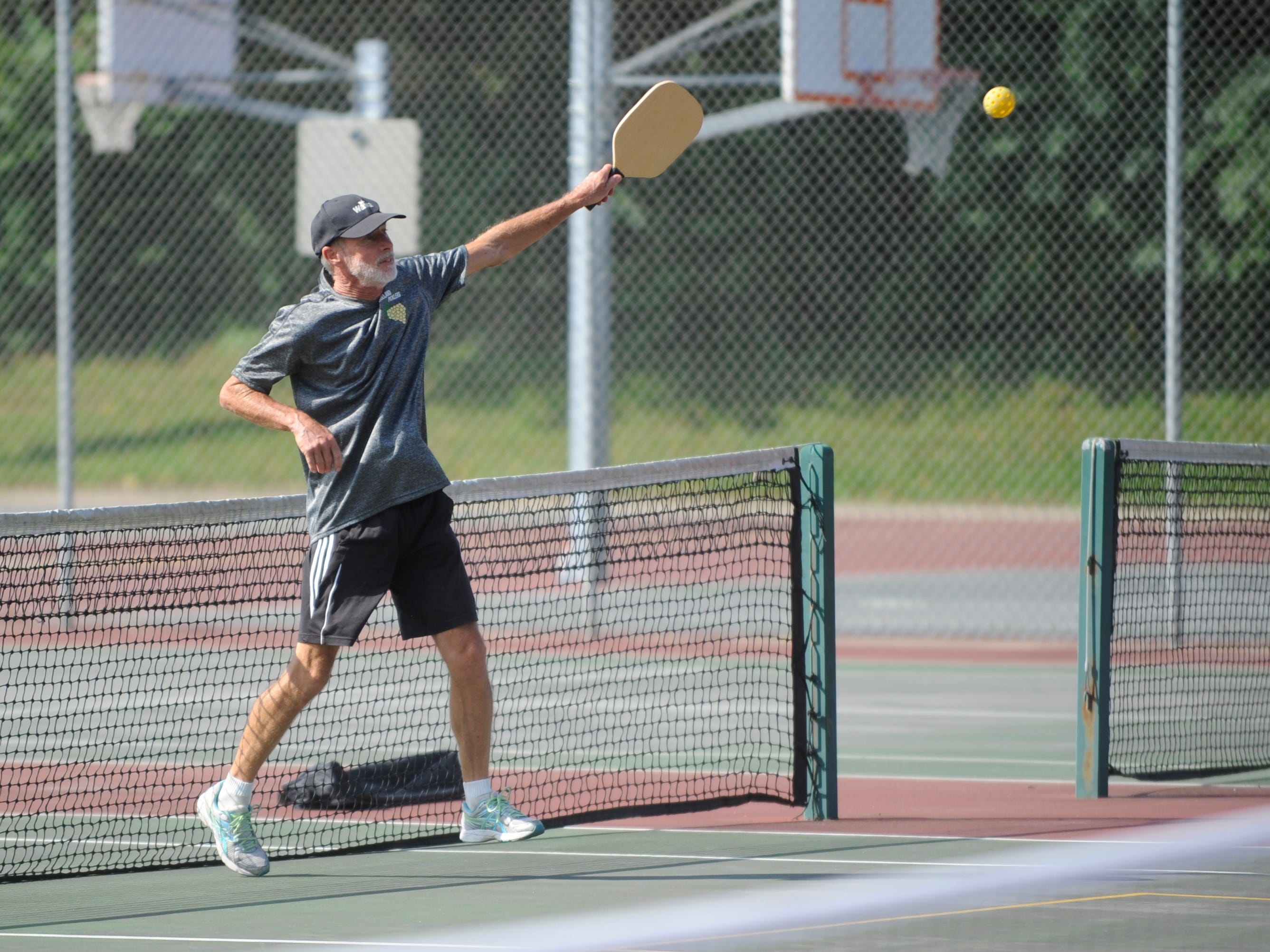 Bill Hayes, 64 of Vineland, hits the ball during a pickleball game at Pagluighi Park on Wednesday, October 3, 2018.