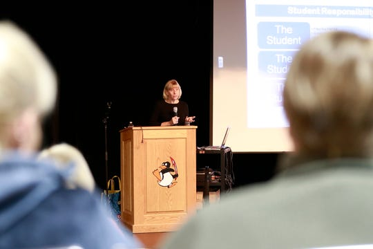 Sharon Hunter presents to parents and students on how to apply for financial aid during a workshop Wednesday, Sept. 26, 2018, at Tri-County High School Auditorium in Plainfield, Wis.