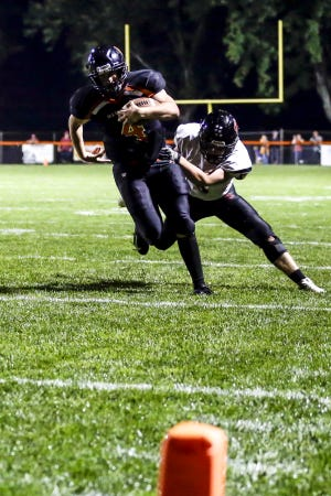 Marshfield quarterback Ryan Krueger passed for five touchdowns in a win over D.C. Everest last Friday as the Tigers improved to 8-0.