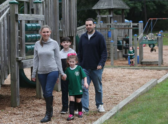 Diane and Eric Udin, along with their children Avery, 5, and Jakob, 8, in the playground after soccer practice  at Roselle Park in Pleasantvlle Oct. 6, 2018.