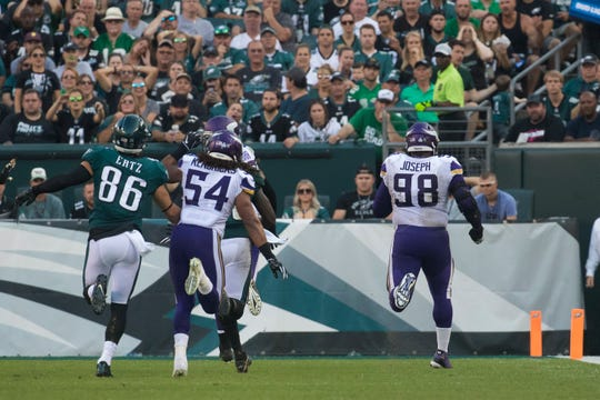Minnesota's Linval Jospeh (98) returns a fumble for a touchdown Sunday at Lincoln Financial Field.