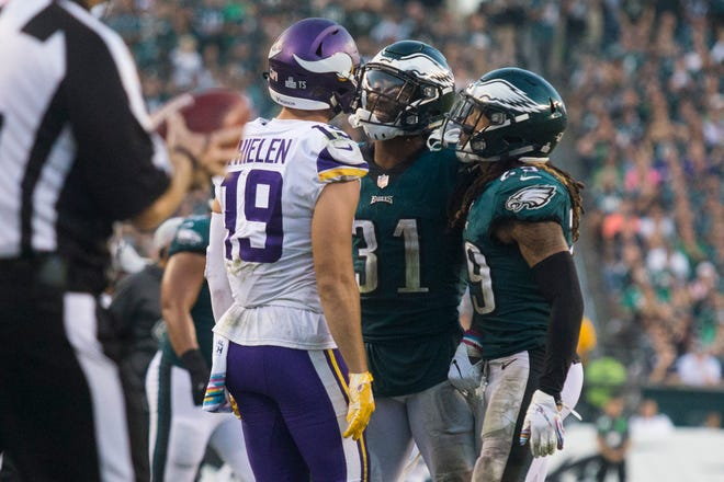 Eagles Jalen Mills (31) and Avonte Maddox (29) confront Minnesota's Adam Thielen Sunday at Lincoln Financial Field. Fletcher Cox then came over and shoved Mills away from Thielen.