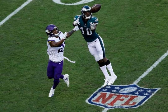 Philadelphia Eagles' Shelton Gibson (18) catches a pass against Minnesota Vikings' Mike Hughes (21) during the first half of Sunday's game.