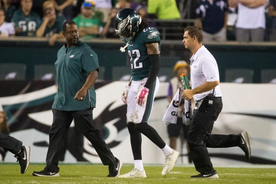 Eagles' Sidney Jones (22) walks off the field with an injury Sunday at Lincoln Financial Field.