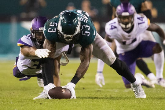 Eagles' Nigel Bradham (53) beats Minnesota's Roc Thomas (32) to recover a fumbled ball Sunday at Lincoln Financial Field.