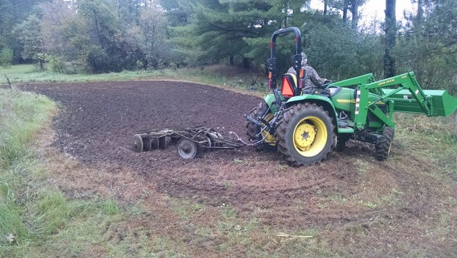 Author Jerry Apps prepares the ground for its annual winter cover crop—this year it is winter rye.