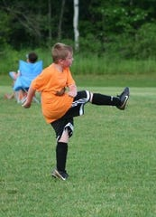 Eight-year-old Ethan playing soccer.