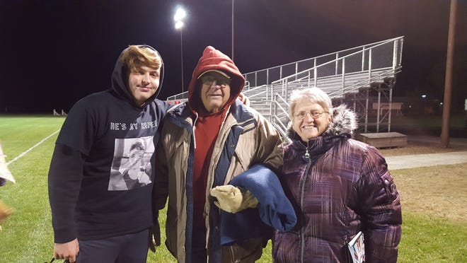 Grandson, Ethan, with Grandpa Bob and Grandma Susan after the game.