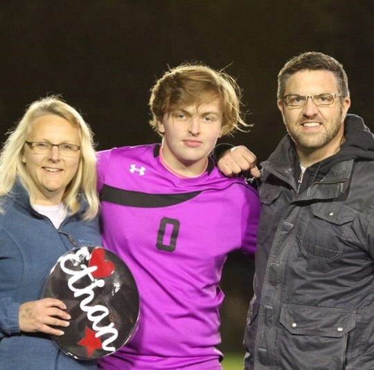Ethan with his parents, Amanda and our son Rob.