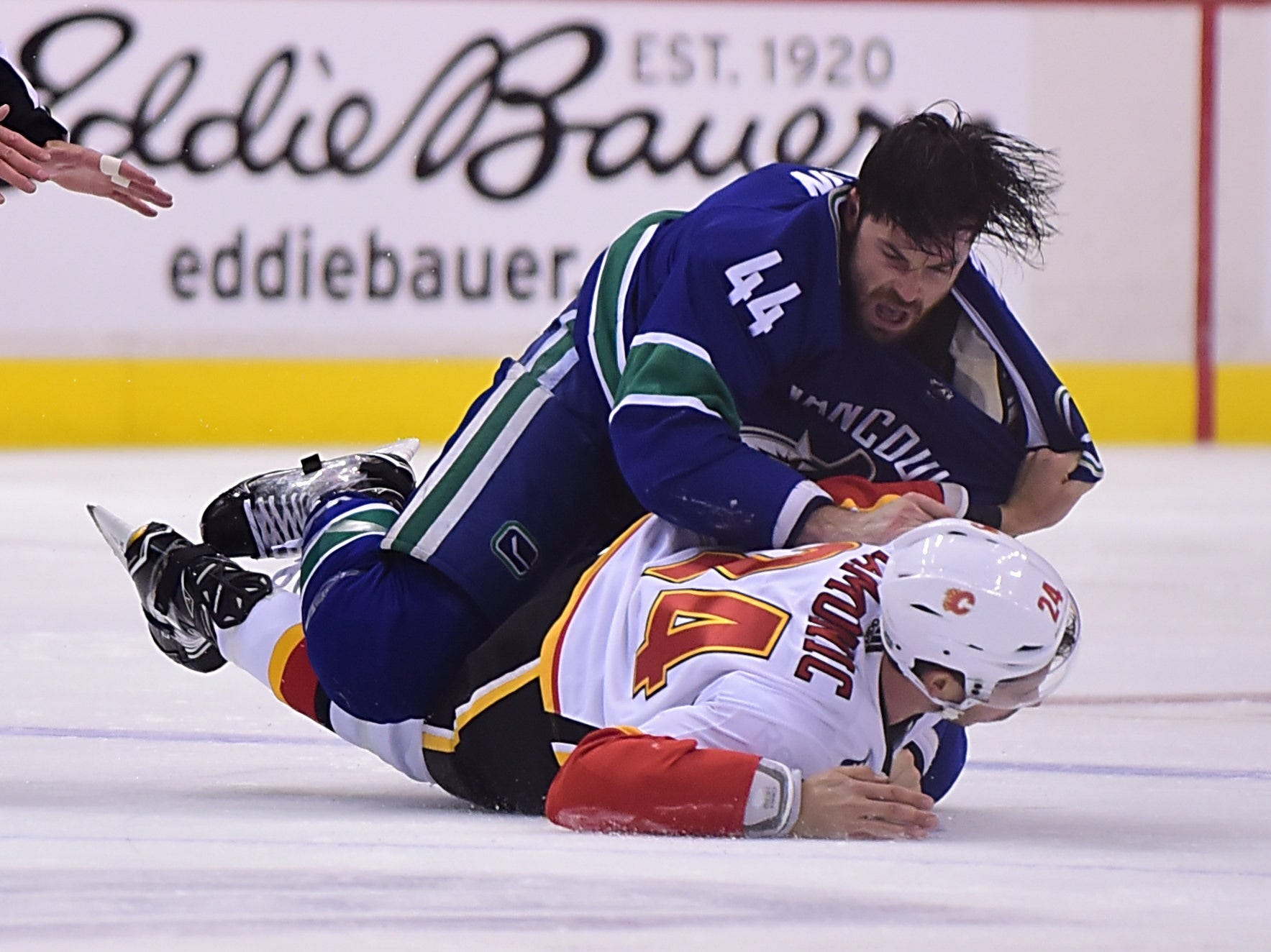Oct. 3: Canucks' Erik Gudbranson vs. Flames' Travis Hamonic.