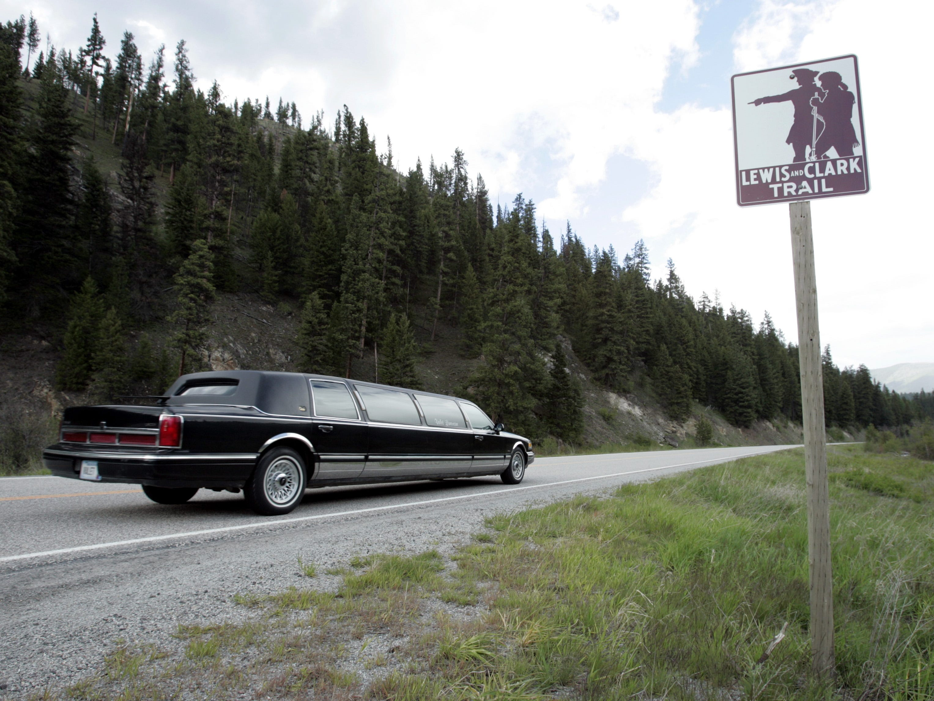 This limo carried passes a Lewis and Clark marker along route 12  near Lolo Pass, Montana, May, 17, 2004.