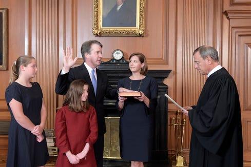 Chief Justice John Roberts swears in Justice Brett Kavanaugh on Oct. 6, 2018.