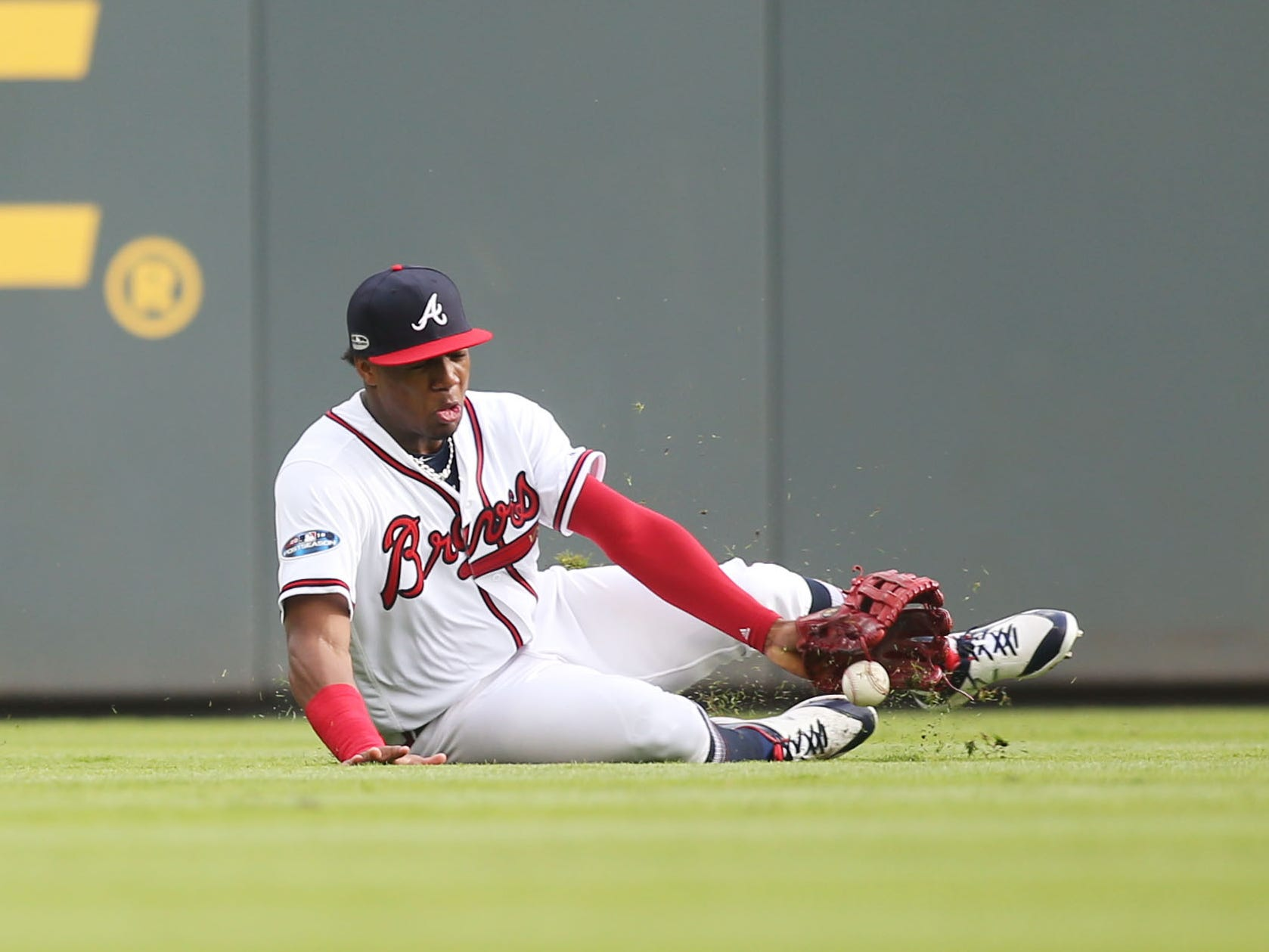 NLDS Game 4: Braves left fielder Ronald Acuna tries to make a catch early in the game.