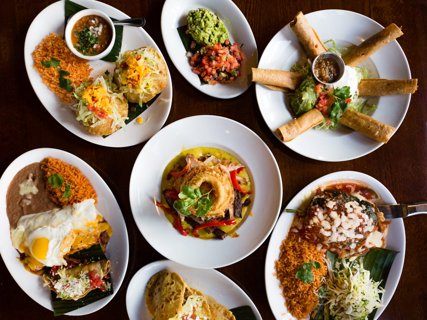 """""""We serve Tex-Mex, but we don't copy everyone else in town,"""" says La Comida co-owner Mario Urtecho. """"You're gonna taste the fresh flavors like a dance in Mexico. Our Tex-Mex menu hasn't changed since we opened four years ago because our customers won't let us."""" You'll find Tex-Mex staples like hand-rolled cheese enchiladas topped with chile con carne, chile rellenos, nachos and fajitas on the menu here, but you can also go off-menu and order hard-shell puffy tacos and gorditas made with fresh corn masa."""