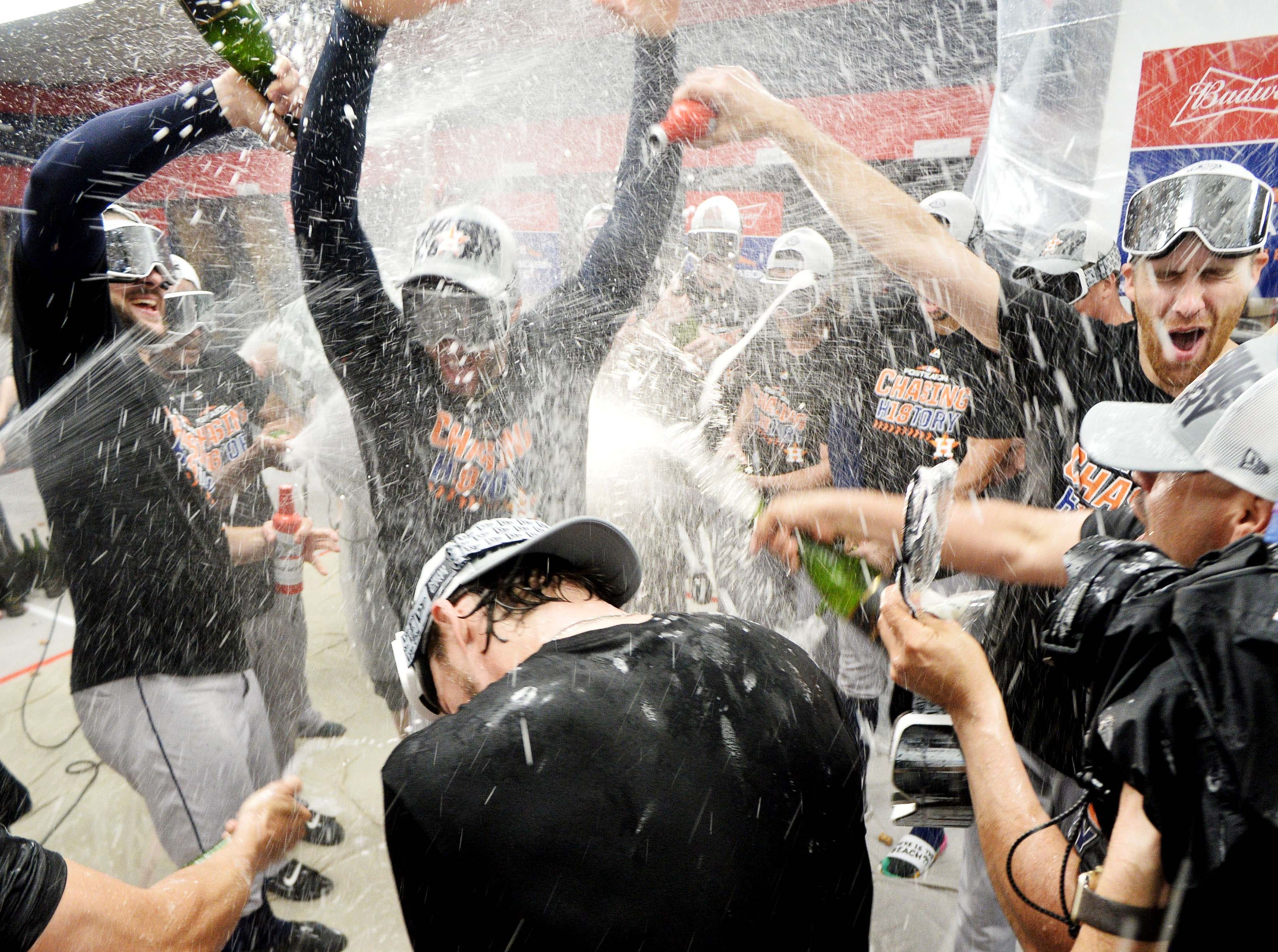 ALDS Game 3: Astros players celebrate in the clubhouse.
