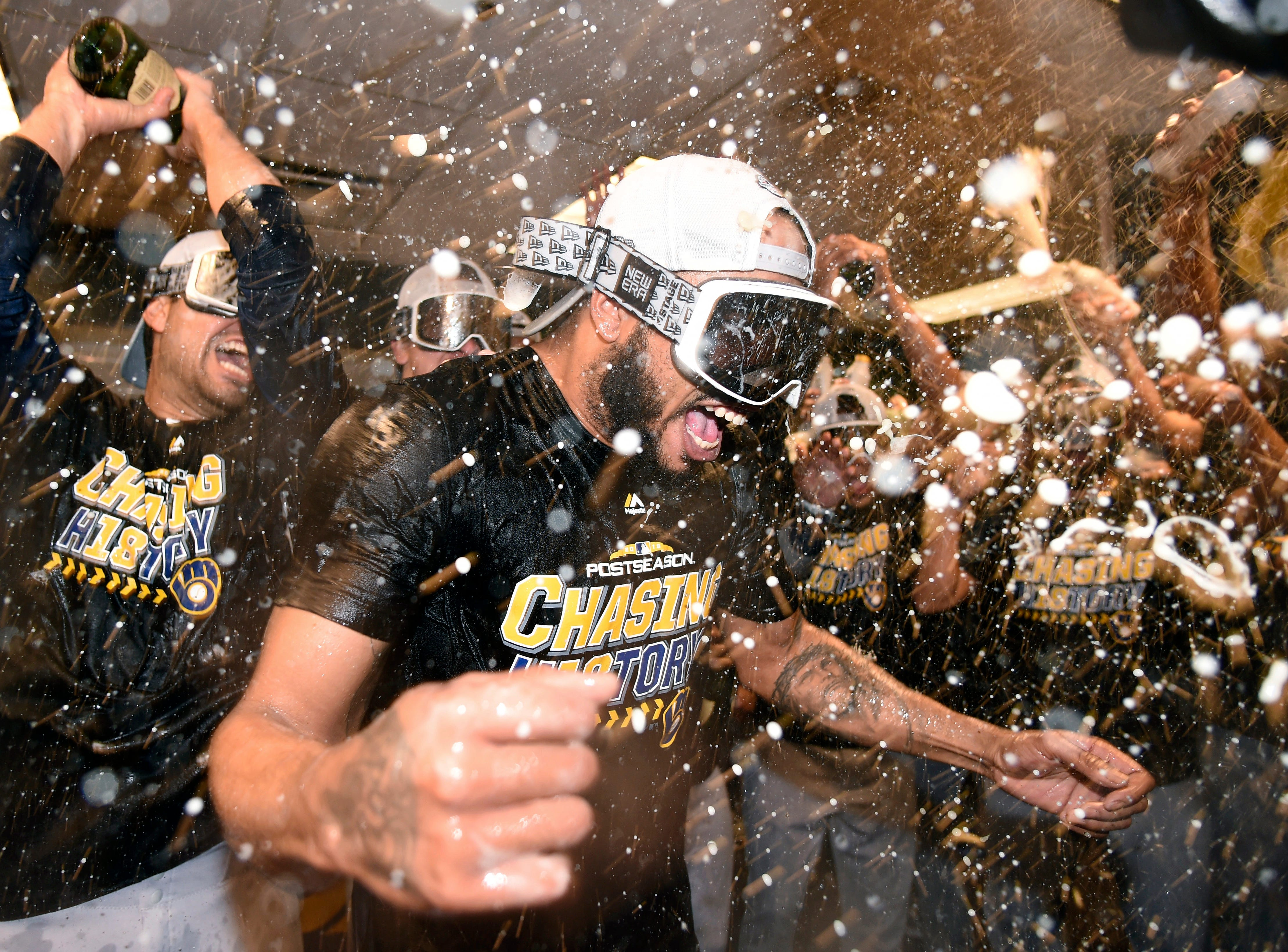 NLDS Game 3: Brewers relief pitcher Jeremy Jeffress is doused by teammates in the clubhouse.