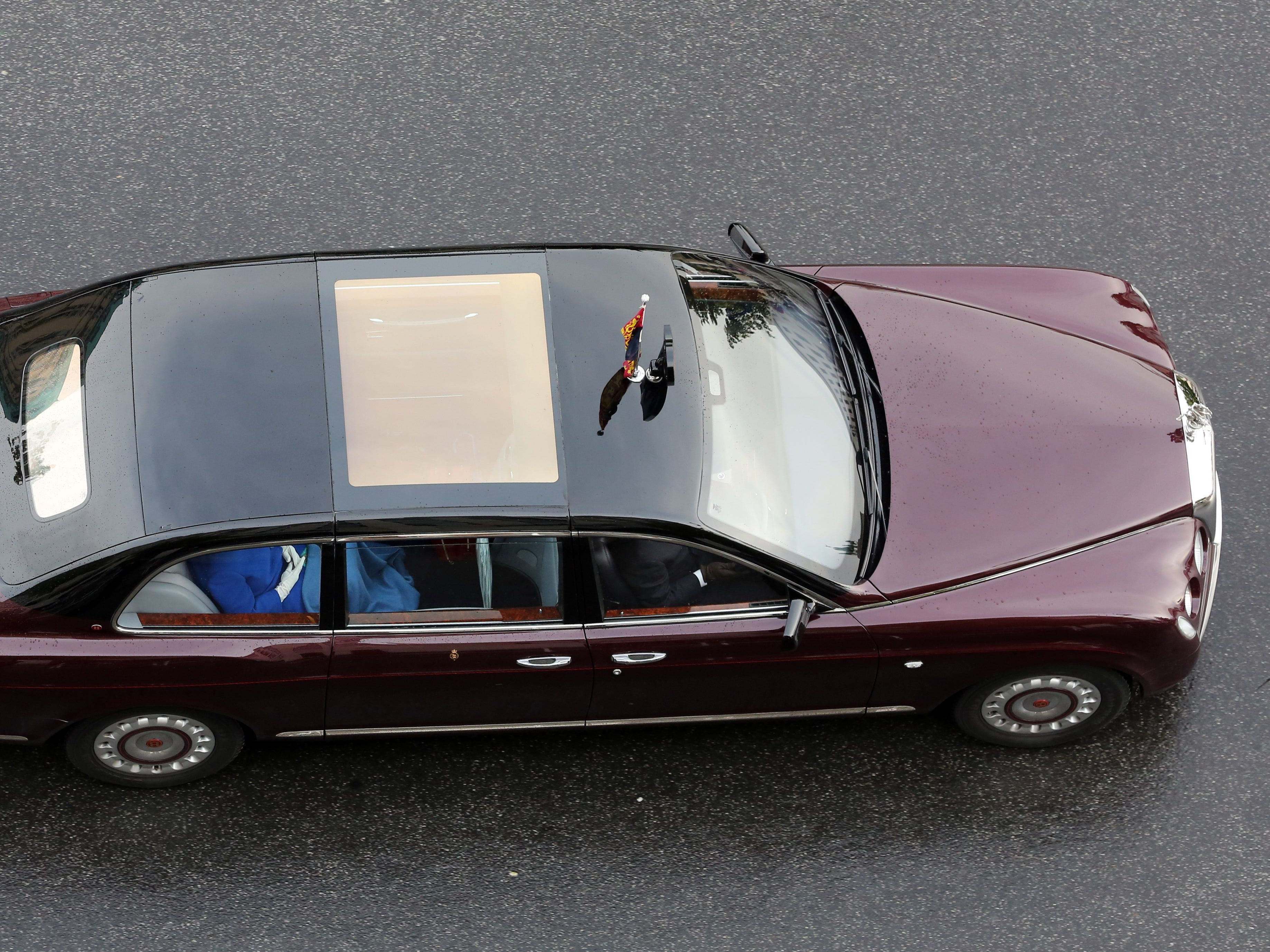 The limousine carries British Queen Elizabeth II and her husband Prince Philip  in Berlin, June 23, 2015.