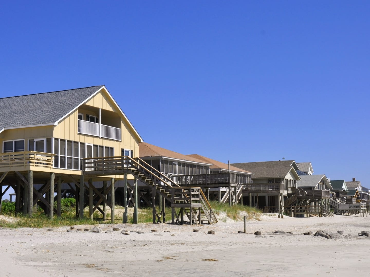 South Carolina: The picturesque seaside town of Pawleys Island is best known for its signature Cypress cottages. There's plenty of history and untouched beaches here, but also lots of attractions to keep you busy whether you want to shop, dine, play outdoors or just relax. Go dolphin-spotting on a Blue Wave Adventures dolphin tour, get a taste of the island's history at the Hopsewee Plantation, or catch a show at the Carolina Opry. If you'll be flying in, consider checking for deals on Twitter. It's one of the best ways to save money for your vacation. Blue Wave Adventures Dolphin Tour: $31.