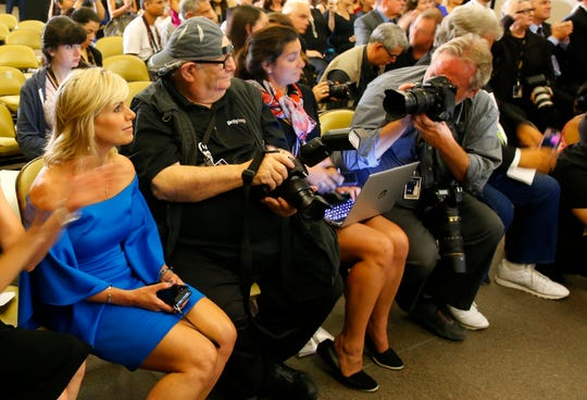Gretchen Carlson, chair of the board of Miss America, left, sits in the audience at the Miss America news conference, Sept. 9, 2018, in Atlantic City, N.J.