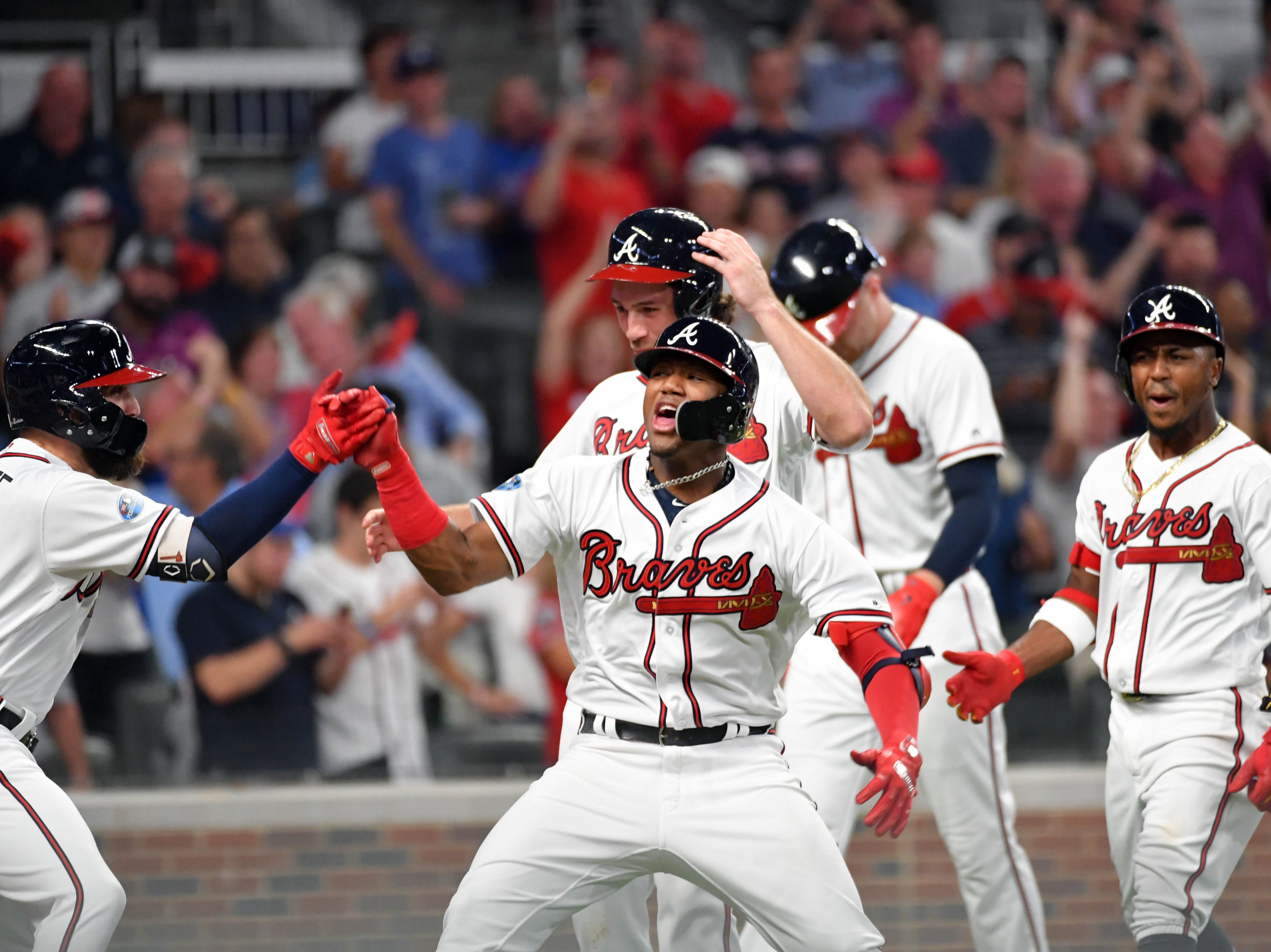 NLDS Game 3: Braves left fielder Ronald Acuna celebrates his grand slam in the second inning.