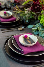 Go dark with a pop of color and name cards for place settings.