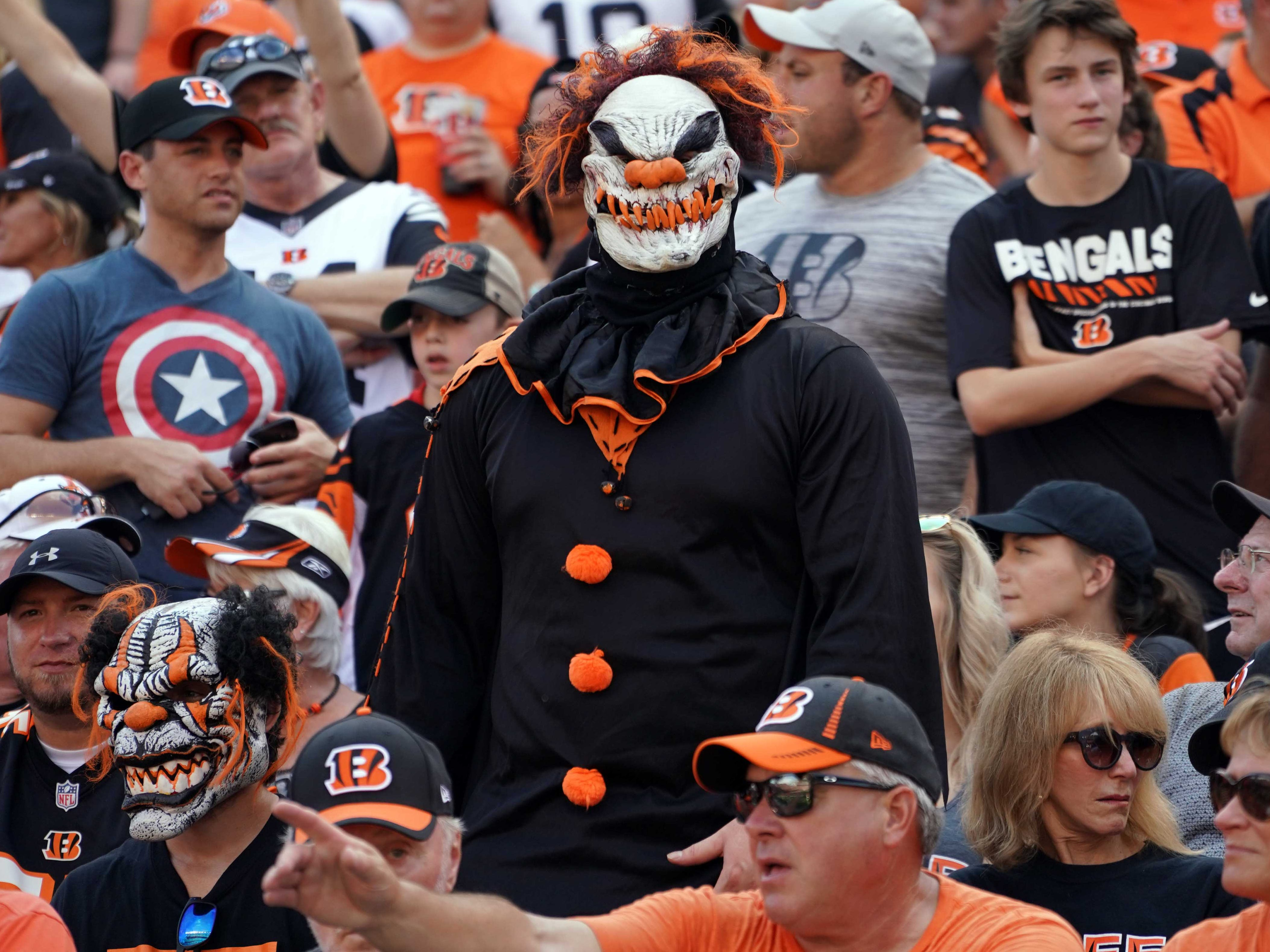A fan stands in a clown costume during the game between the Miami Dolphins and Cincinnati Bengals at Paul Brown Stadium.
