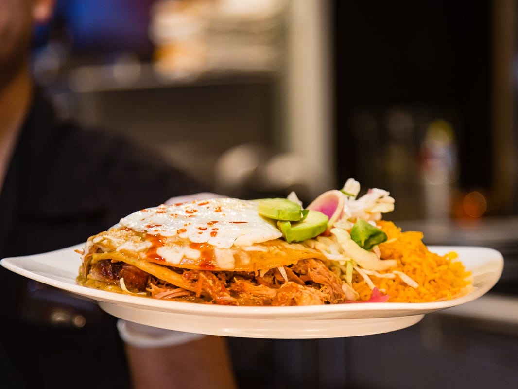 Riffing on classic Tex-Mex enchiladas, Beto and Son serves stacked enchiladas stuffed with barbacoa or roasted chicken then topped with avocados and a fried egg.