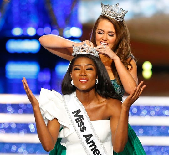 Miss New York Nia Franklin reacts after being named Miss America 2019, as she is crowned by last year's winner Cara Mund, Sept. 9, 2018, in Atlantic City, N.J.